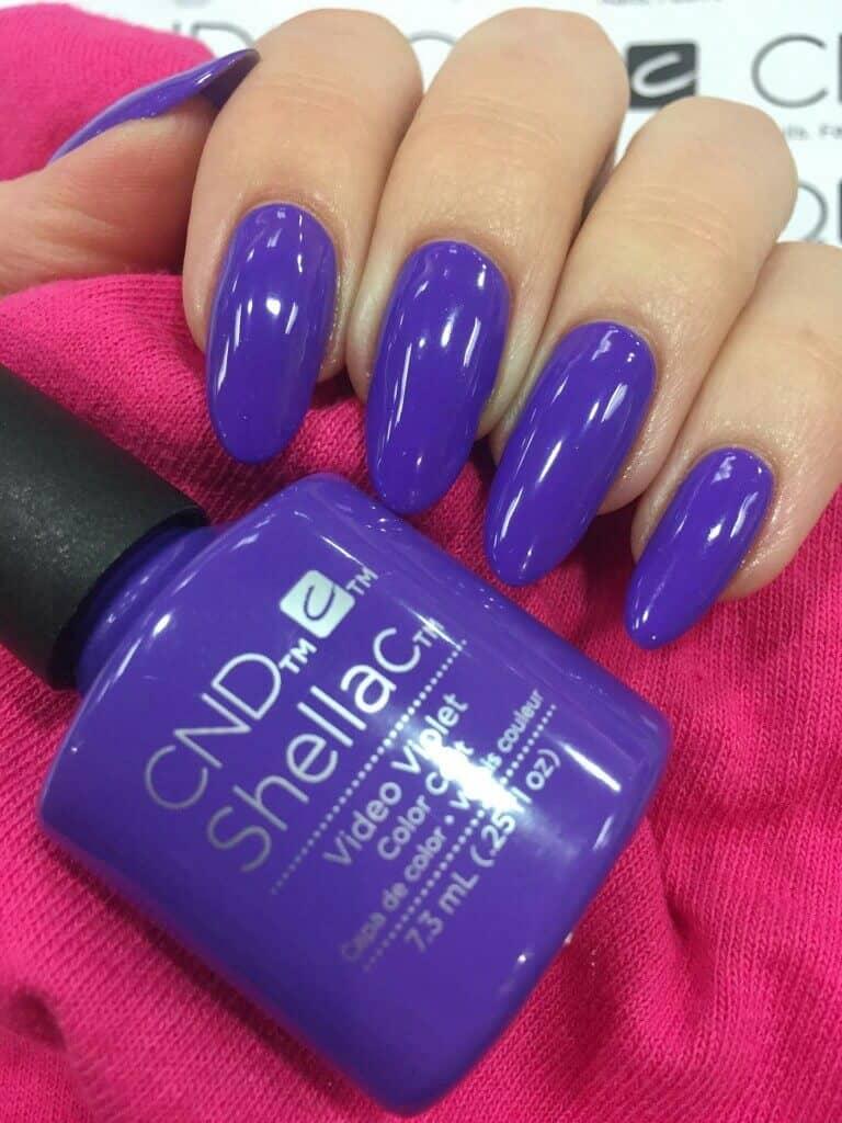 Vibrant Violet Stiletto Nail Manicure