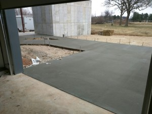 The massive expanse of concrete in the front of the house only half-done.