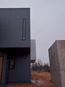 All three exterior materials together: concrete, steel, and fiber cement.