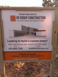 The builder apparently wasn't happy with the dinky little sign that was planted in the yard so he put up this giant timber-framed sign with a rendering of the house on it.