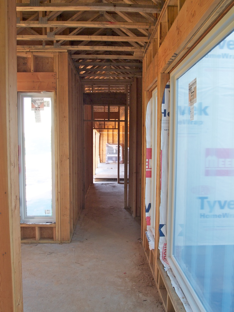 This is the hallway leading to the garage.  It was really exciting to see those huge windows installed.