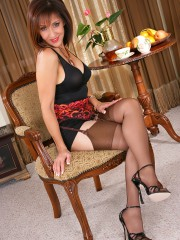 Hot housewife Roni posing in full fashioned stockings