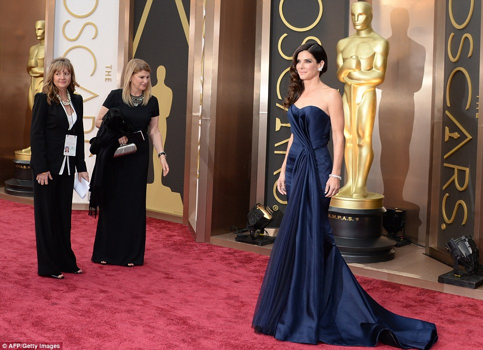 A grand entrance: Sandra Bullock arrived in a navy blue Alexander McQueen gown, hoping to scoop her second Best Actress Oscar