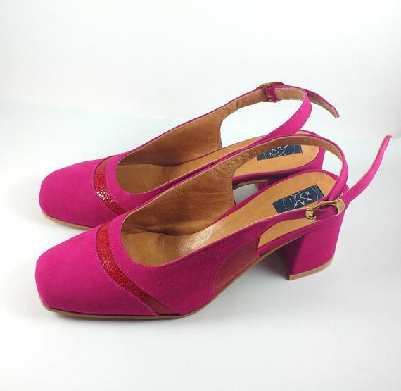 Hot pink suede pumps
