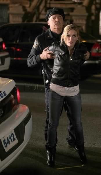 Hilary duff handcuffed