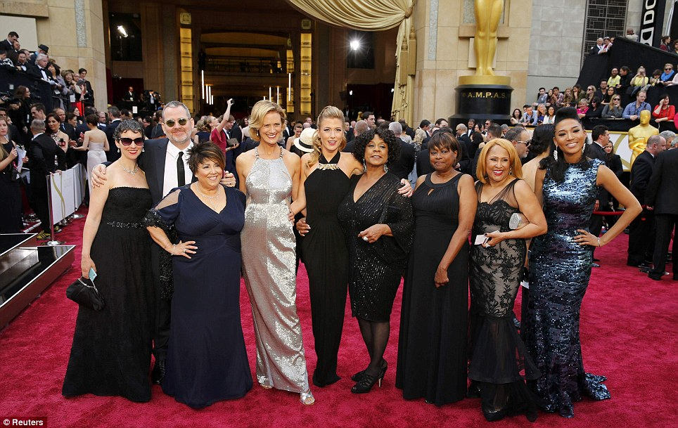 Taking centre stage: The cast of Oscar-winning documentary 20 Feet From Stardom strike a pose on the carpet