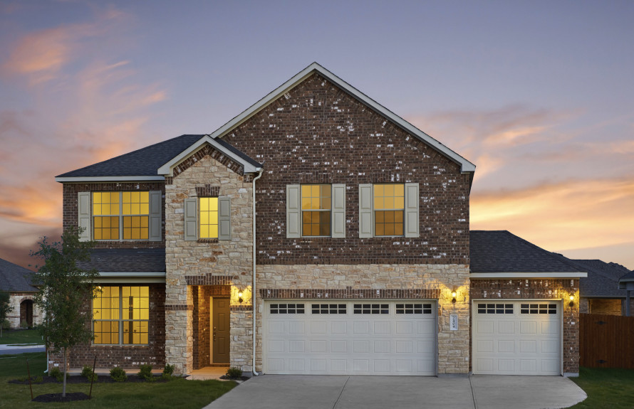Soledad - Elevation B with Brick Exterior and Stone Accents. Three-car garage is optional.