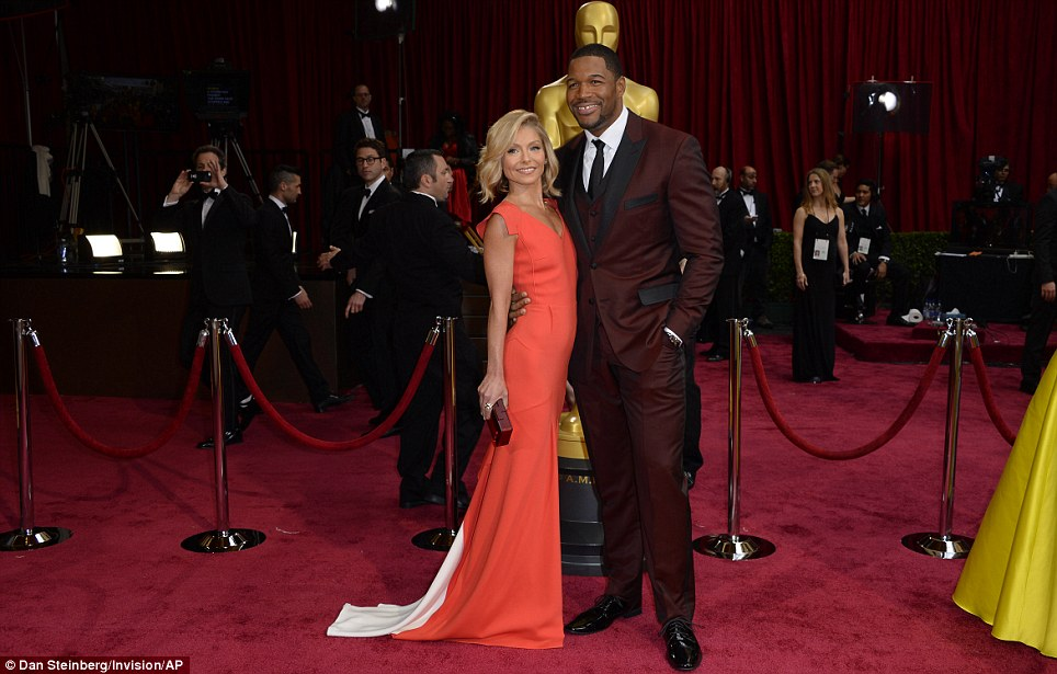 Early arrivals: Kelly Ripa looked stunning in a tangerine gown as she arrived with her co-host Michael Strahan