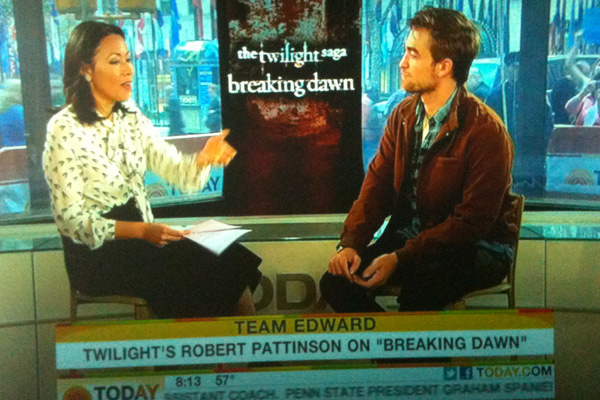 Kristen stewart admits to dating robert pattinson 2011