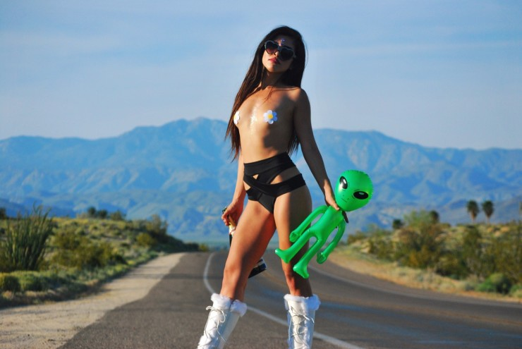 Desert highway badass lady. Wearing Black Kiki Bottoms for festivals, raves and swim. Also wearing White Daisy Pasties and furry rave boots.