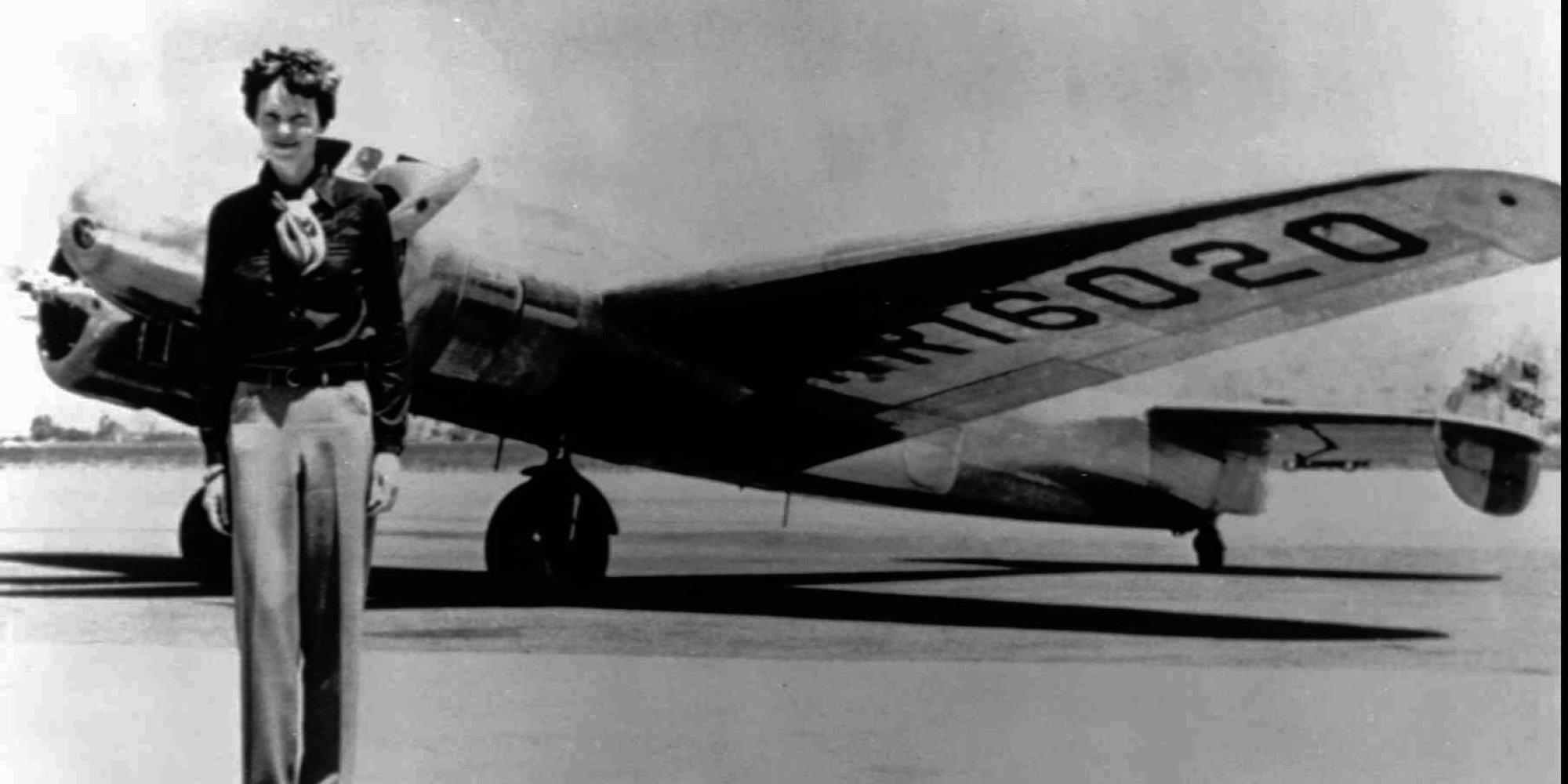 Amelia beside the Electra Plane