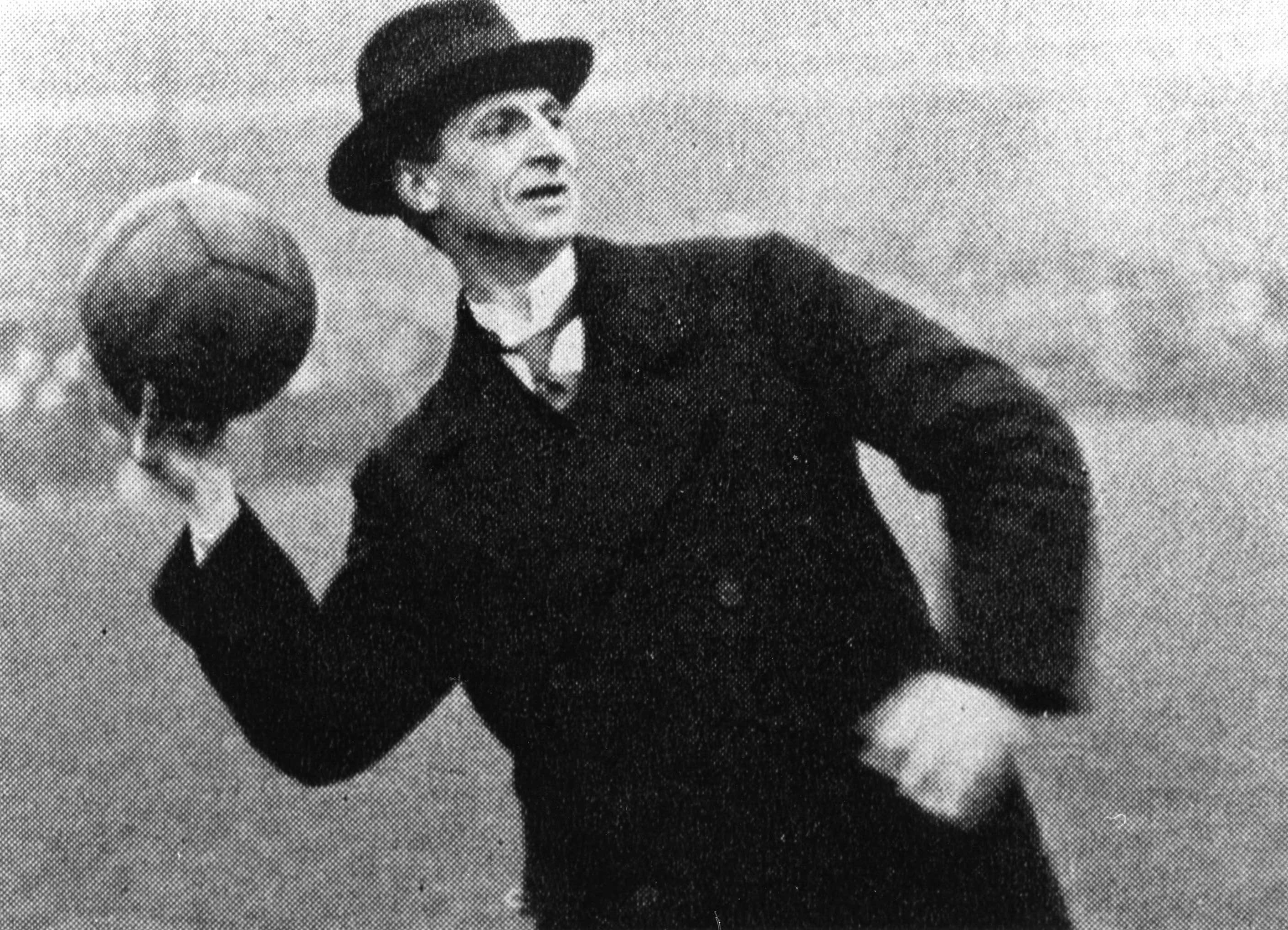 Eamon de Valera throwing in the ball at Croke Park, 1919