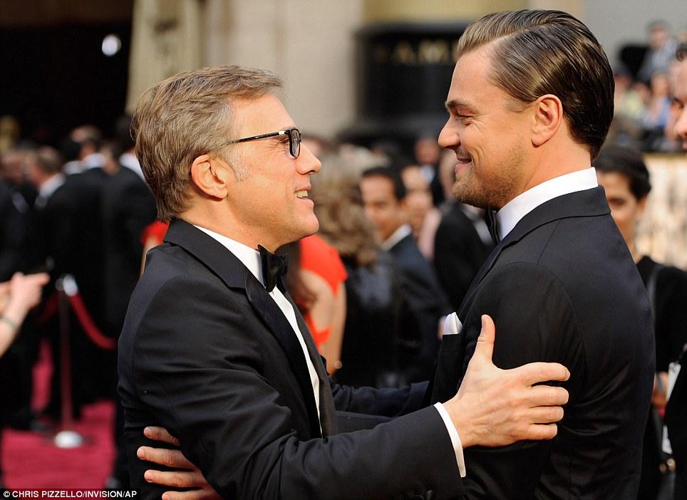 Good to see you: Leonardo DiCaprio embraces his Django Unchained co-star Christoph Waltz on the red carpet
