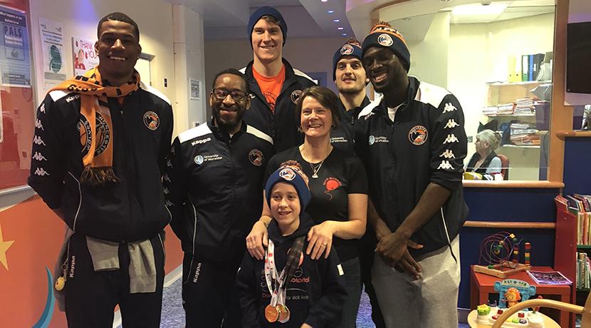 Basketball stars help lift spirits at hospital visit