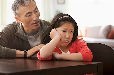 619-06936750 © Masterfile Royalty-Free Model Release: Yes Property Release: Yes Father comforting pouting daughter