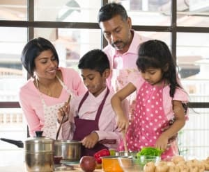 depositphotos_121865700-stock-photo-indian-family-cooking-at-home