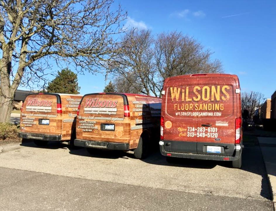 Image showing three Wilson's company vans lined up side-by-side