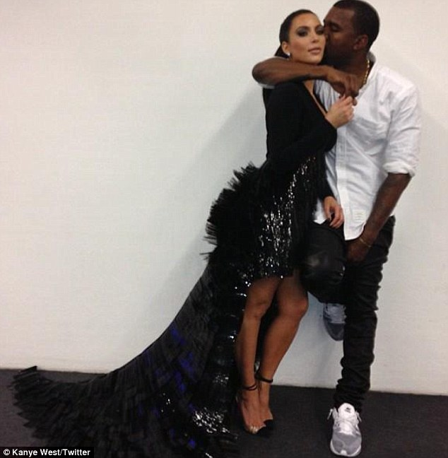 Whirlwind romance: Kanye tweeted this picture of him and Kim on November 12, writing 'My baby'