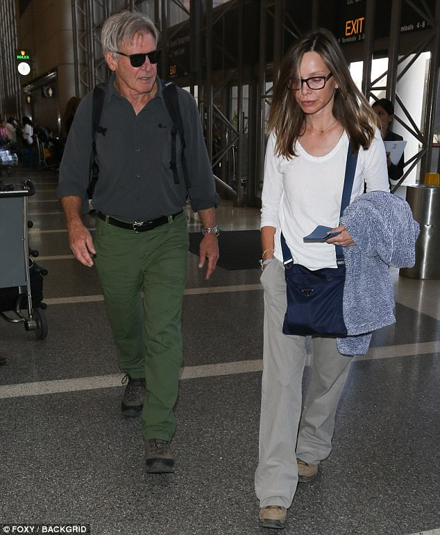 Keeping it simple: Calista, who is best known for starring in Ally McBeal from 1997 to 2002, carried a warm jacket over one arm