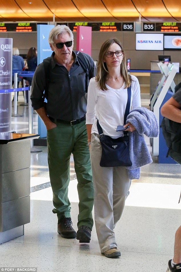 On their way: Supergirl actress Calista looked relaxed in a long-sleeved white T-shirt and cream trousers