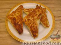 Фото к рецепту: Треугольные пирожки из лаваша