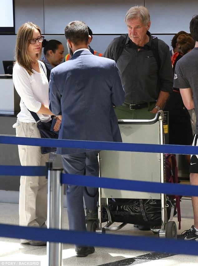 Security screening: Harrison and Calista chatted to a member of staff at the airport