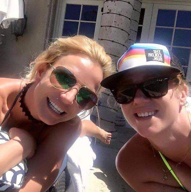 Britney is chilling by the pool today with her friend