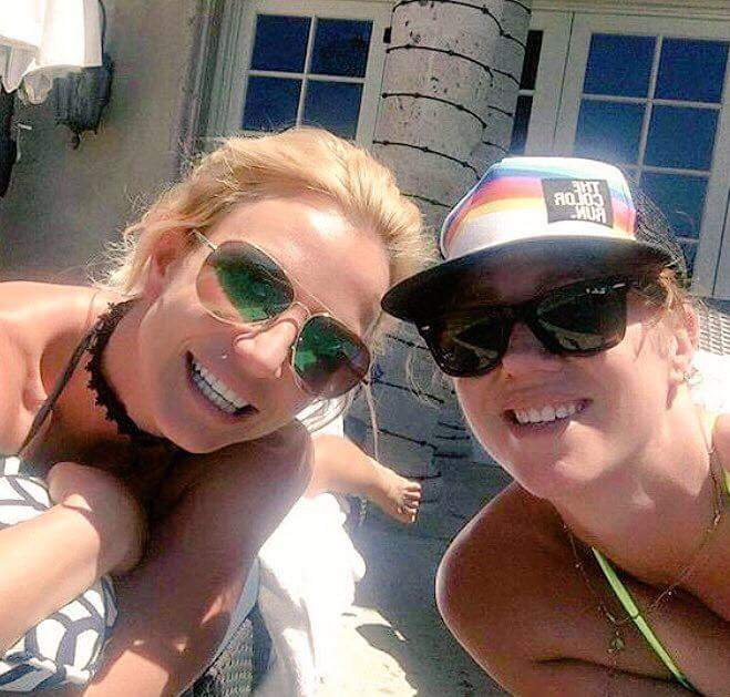 Britney and her bestie chilling by the pool today.