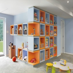 An Unfinished Basement Transformed Into A Playroom See how this basement went from nothing to a colorful and organized, fun-filled play space. Do you have an unfinished basement that you'd love to remodel into a TV room, workout space, or playroom for your kids? This New York home took on the huge task of renovating an unfinished basement and turned it into a functional and fun space. With the help of Architect Eisner Design LLC, this basement was created by demolishing a 38′ long concrete foundation wall and transforming it into a fully glazed wall that leads to sliding doors accessing the backyard.  The biggest renovation of this basement was the large play area that includes colorful tones of blue, yellow, and orange in a wrap-a-round cubicle custom storage system and an arts and crafts desktop area. For $400k, this basement renovation turned a dull unfinished basement into a playful space that encourages organization for the young children that live in the home.  Take a look at the transformation of this basement that benefitted both the parents and kids of this home!