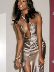 Actress Gabrielle Union, adjusts her dress, prior to posing for photographers at the 36th NAACP Image Awards in Los Angeles March 19, 2005. Union was a presenter at the awards show. The awards, presented by the National Association for the Advancement of Colored People, honor people of color in the entertainment industry, and will be telecast in the United States on the Fox television network March 25. REUTERS/Fred Prouser NAACP IMAGE AWARDS