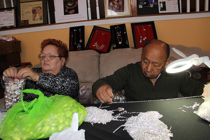 It is a family business, Evelyn's parents helping her finish one of her largest orders for  Virgin Island jewelry shops Little Switzerland