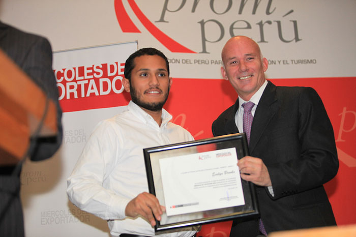 Ellyot Estela ( Evelyn's brother) receiving a recognition from the Peruvian government office PROM-PERU
