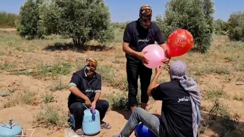 Palestinian protesters fire incendiary balloons towards Israel days after a shaky ceasefire
