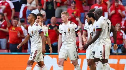 Belgium qualify for last 16