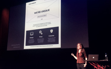 Jen Simmons with a sarcastic image behind her mocking standard web design patterns