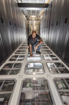 """""""My job is to eventually put cooling towers out of business,"""" said David J. Martinez, pictured here, who led development on the new supercomputer cooling method. (Image courtesy of Sandia National Laboratories.)"""