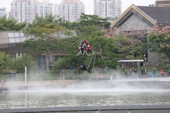 KuangChi Martin Jetpack hovering over the OCT Harbour. Photo courtesy of KuangChi Science.