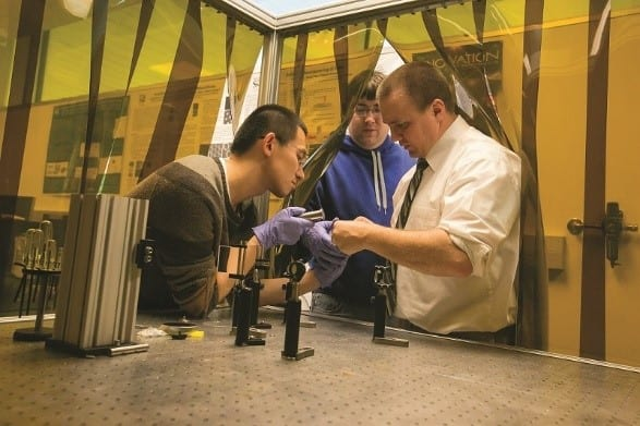 Dr. Kinzel and graduate students Chuang Qu and Jacob Wilson work to scale up the fabrication of metamaterials to control thermal transport. (Image courtesy of Missouri S&T.)