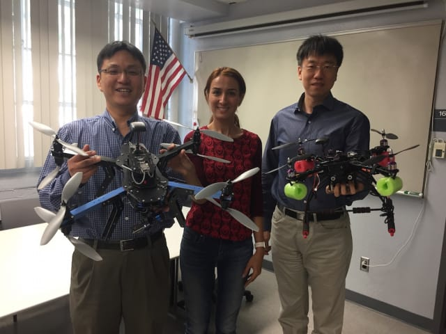 University of Arizona systems engineering researchers Young-Jun Son (left), Sara Minaeian and Jian Liu are using these unmanned aerial drones to design an autonomous border patrol surveillance system. (Image courtesy of UA College of Engineering.)