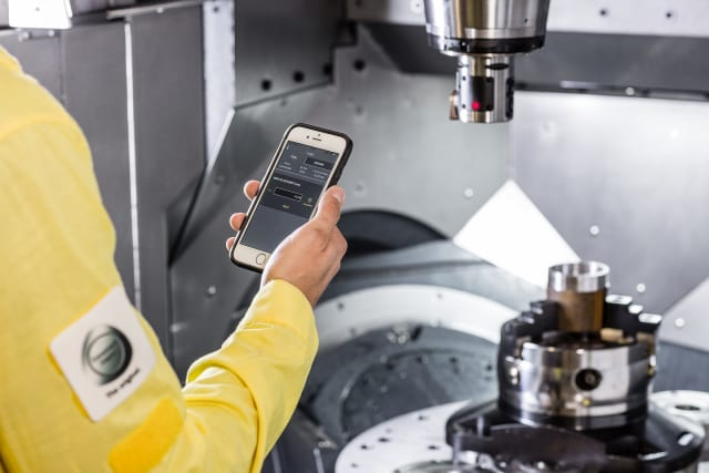 A machine operator analyzes readings from a CoroBore connected machine. (Image courtesy Sandvik Coromant.)
