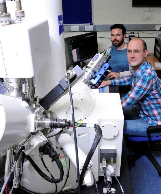 Felix Hofmann and Edmund Tarleton, both authors of the paper, at the FIB instrument at the Department of Materials, University of Oxford, UK. (Image courtesy of Oxford University.)