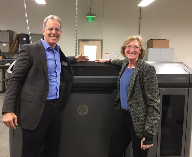 HP's president of 3D printing, Stephen Nigro and Proto Labs president and CEO Vicki Holt at Proto Labs' 77,000-sqft additive manufacturing facility in Cary NC. (Image courtesy of Proto Labs.)