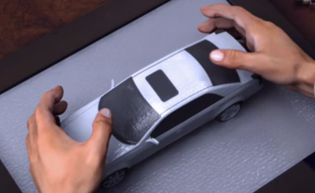 Concept for a designer interacting with a claytronic model of a car. (Image courtesy of Carnegie Mellon.)