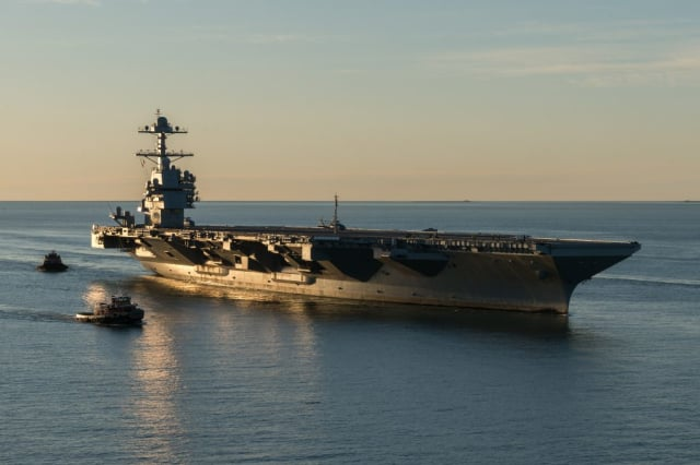 The USS Ford at its commissioning ceremony. This ship is massive! At a length of 1,106 feet, the USS Ford is the largest aircraft carrier in the world and will carry 2600 crew members when it officially deploys in 2020. (Image courtesy of the US Navy.)