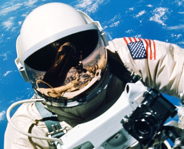 On June 3, 1965, Ed White took this picture in third orbit as he backed away from the Gemini spacecraft while floating high above the Pacific Ocean. (Image courtesy of NASA.)