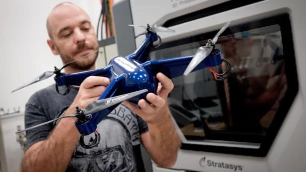 Keane holding his drone, 3D-printed in ULTEM with embedded electronics. (Image courtesy of Stratasys.)