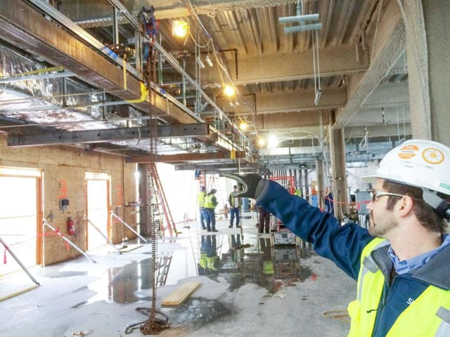Onsite at Novartis, Skanksa received 600 assemblies from various shops and sequences onto the floors and merged into the above ceiling infrastructure. (Image courtesy of Skanska.)