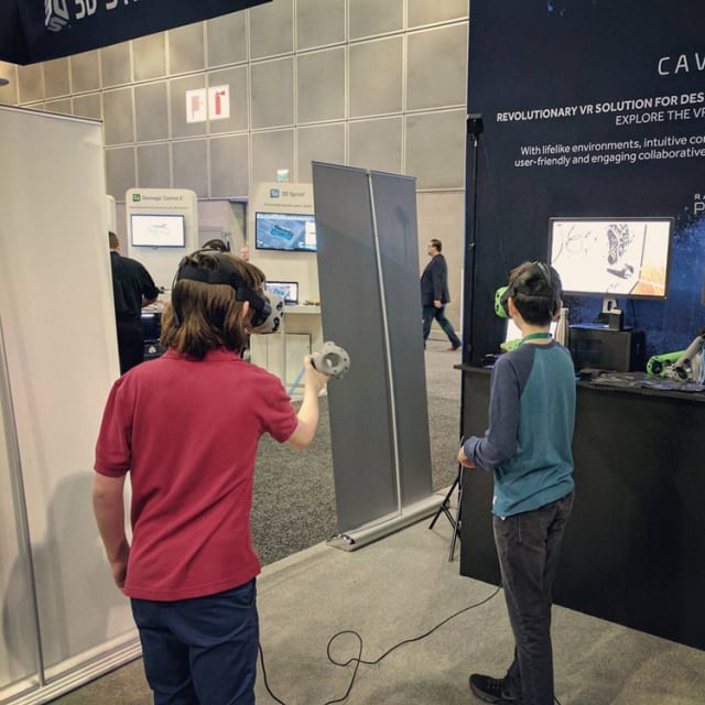 A few youngsters get their immersive CAD on at the CAVRNUS booth in Los Angeles at SOLIDWORKS World 2017 with some HTC Vive headsets strapped on. (Image courtesy of CAVRNUS.)