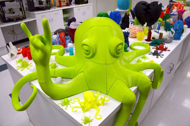 The LulzBot booth at CES 2017, featuring a massive rocktopus 3D printed with the MOARstruder. (Image courtesy of LulzBot.)