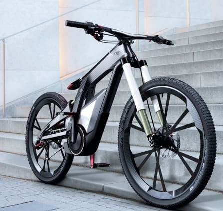 "Audi e-bike Wörthersee is estimated to cost $20K. Push a button for the seat to move into place. Top speed is 50 mph with rider assistance, but it is also designed for ""sporty handling"" and tricks. The carbon fiber frame contributes only 1.6 kg to 11 kg of the total weight (without battery, camera and other electronics). (Image courtesy of Audi)"